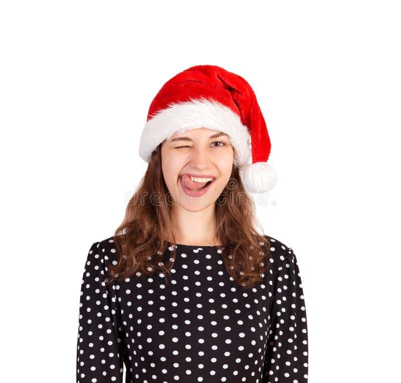 Retrato da mulher bonita alegre no vestido menina emocional no chapéu do Natal de Papai Noel isolado no fundo branco Concep do fe imagens de stock