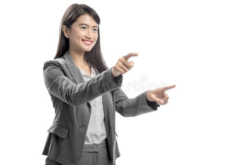 Retrato da mulher de negócio asiática que toca em algo com seu dedo imagens de stock