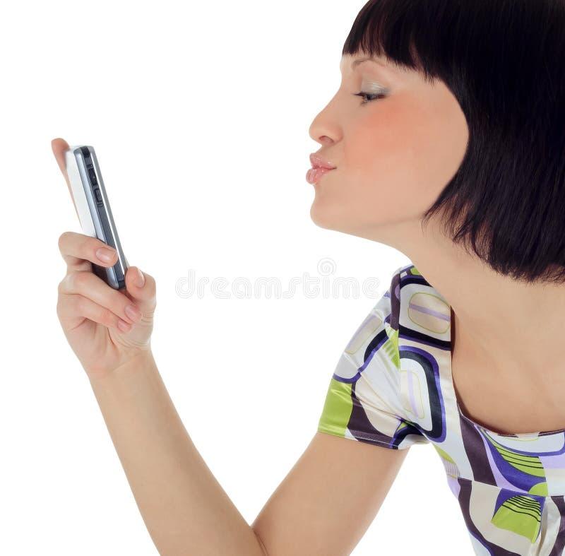 Retrato da mulher feliz com telefone de pilha imagem de stock royalty free