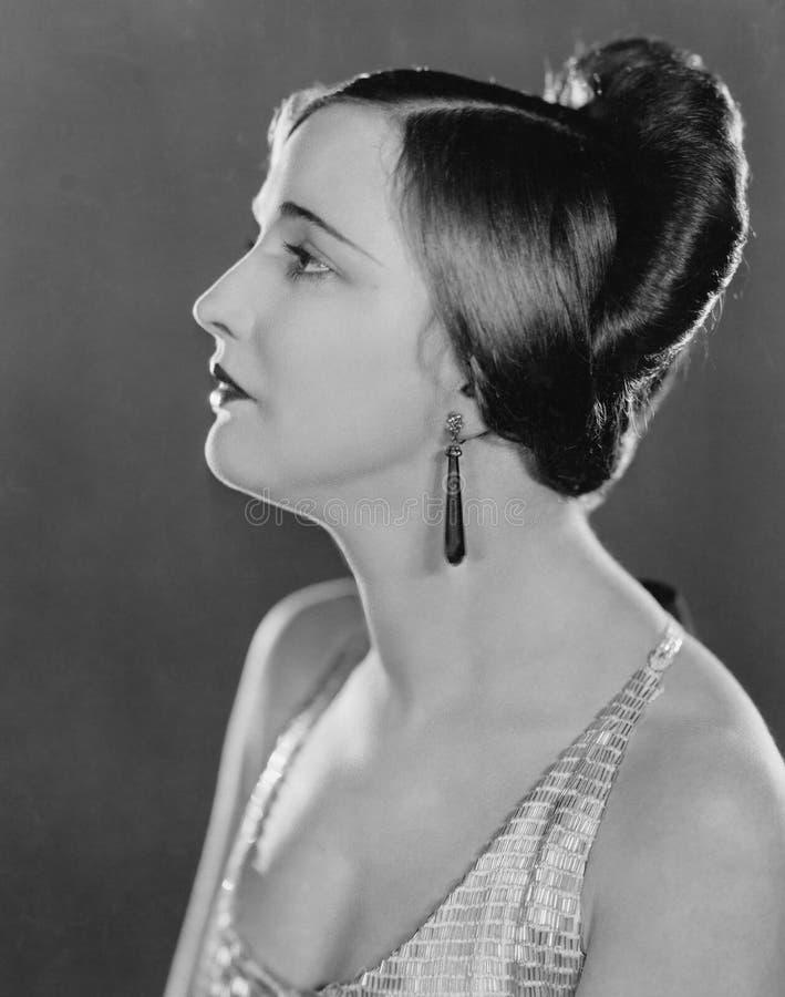 Retrato da mulher no perfil (todas as pessoas descritas não são umas vivas mais longo e nenhuma propriedade existe Garantias do f fotografia de stock