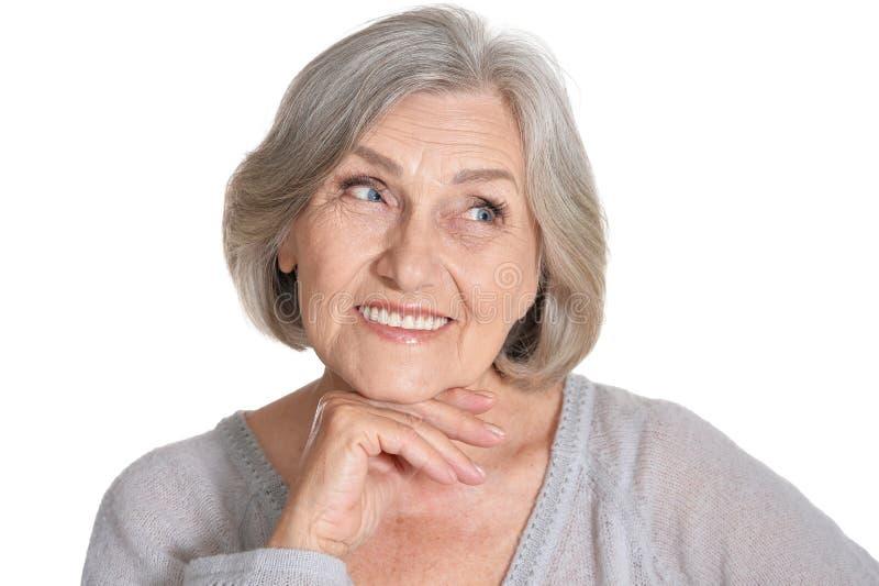 Retrato da mulher superior bonita no fundo branco imagens de stock