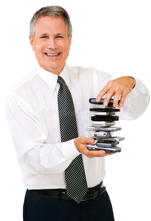 Retrato da pilha da terra arrendada do homem de negócios de telefones imagens de stock