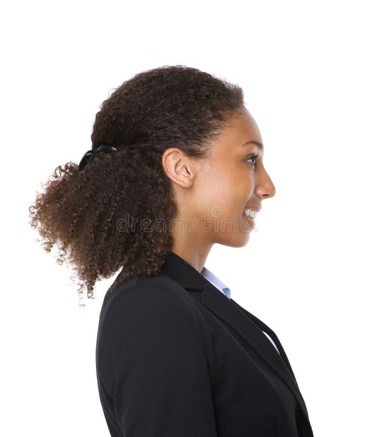 Retrato da vista lateral do um SMI novo da mulher de negócio imagem de stock royalty free