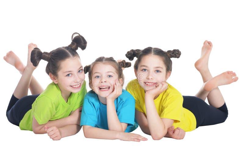 Retrato das meninas bonitos que levantam no fundo branco fotografia de stock royalty free