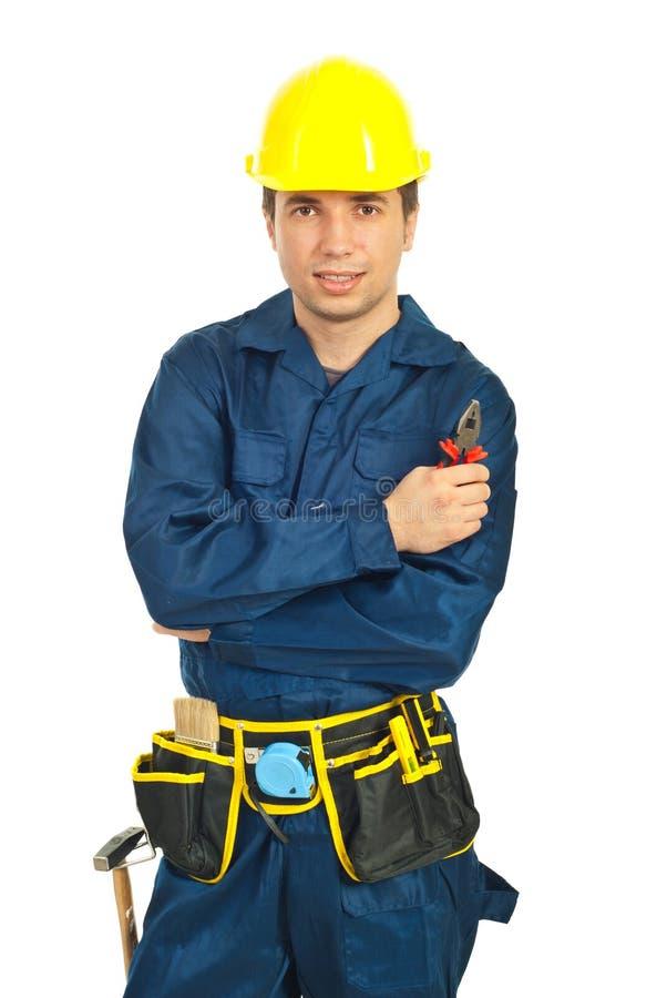Retrato de alicates da preensão do homem do trabalhador fotos de stock