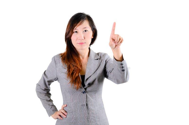 Retrato de apontar de sorriso feliz da mulher de negócio fotografia de stock royalty free