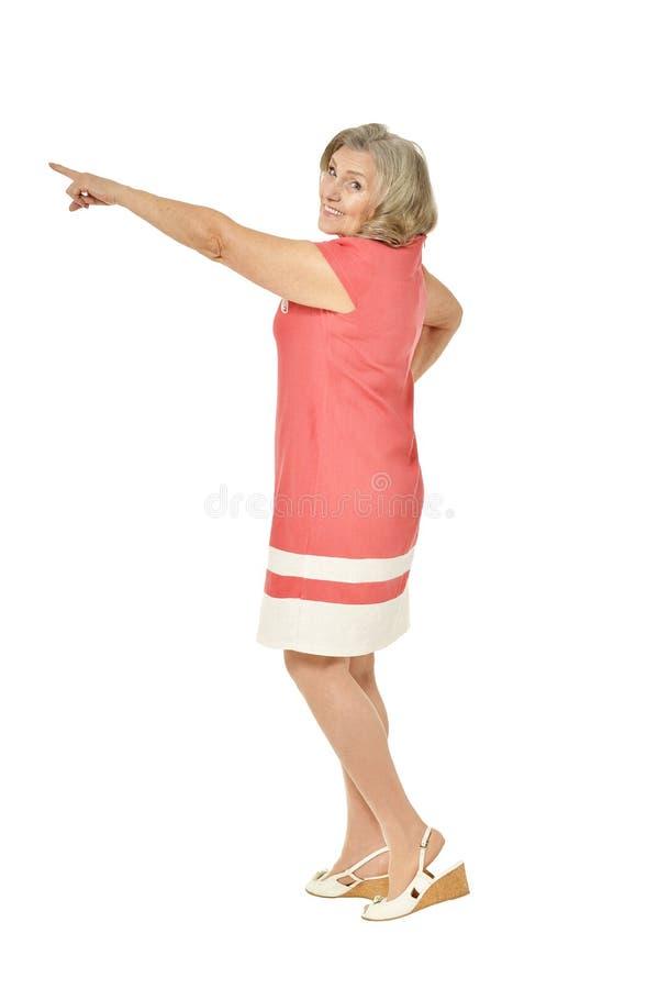 Retrato de apontar superior bonito da mulher isolado no fundo branco fotos de stock