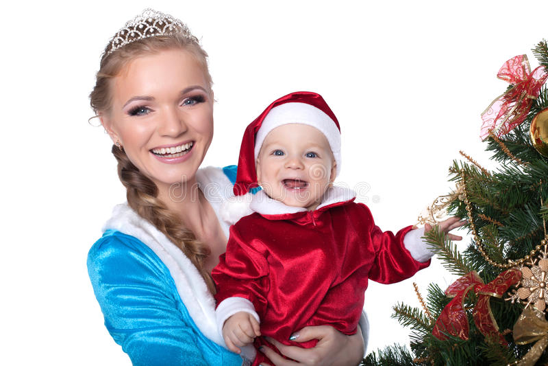 Retrato de bebê-Santa e da donzela felizes da mamã-neve fotos de stock royalty free