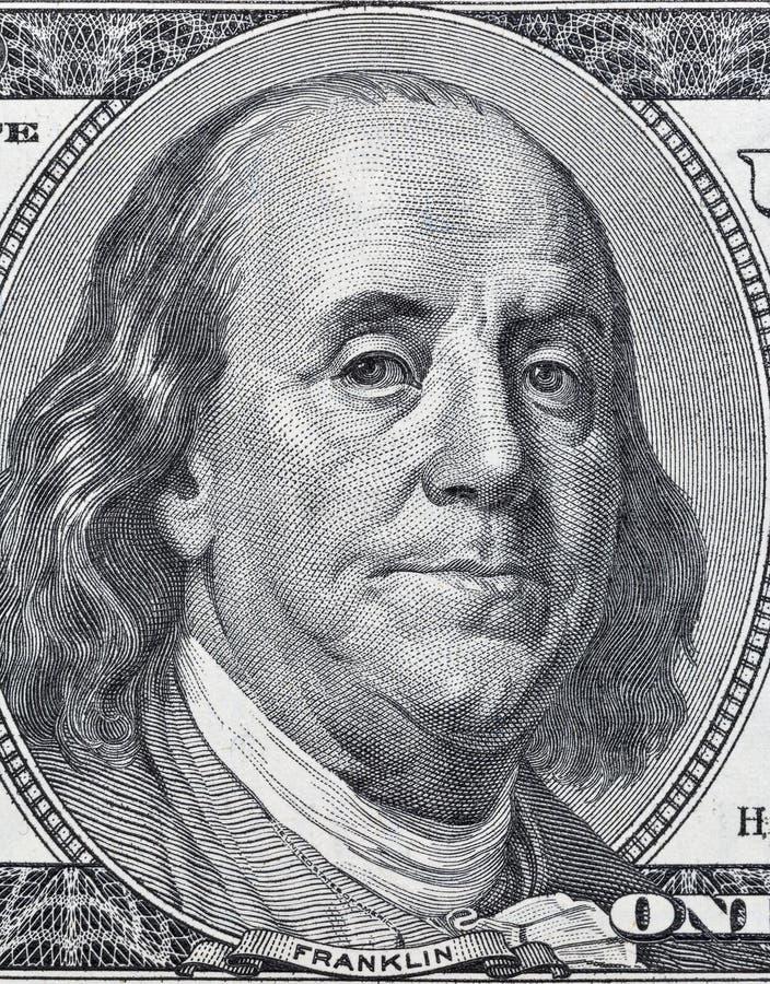 Retrato de Benjamin Franklin en cientos primers del billete de dólar fotografía de archivo