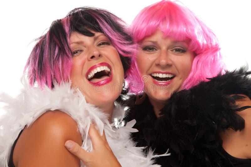Retrato de dois cor-de-rosa e de meninas de cabelo pretas imagens de stock