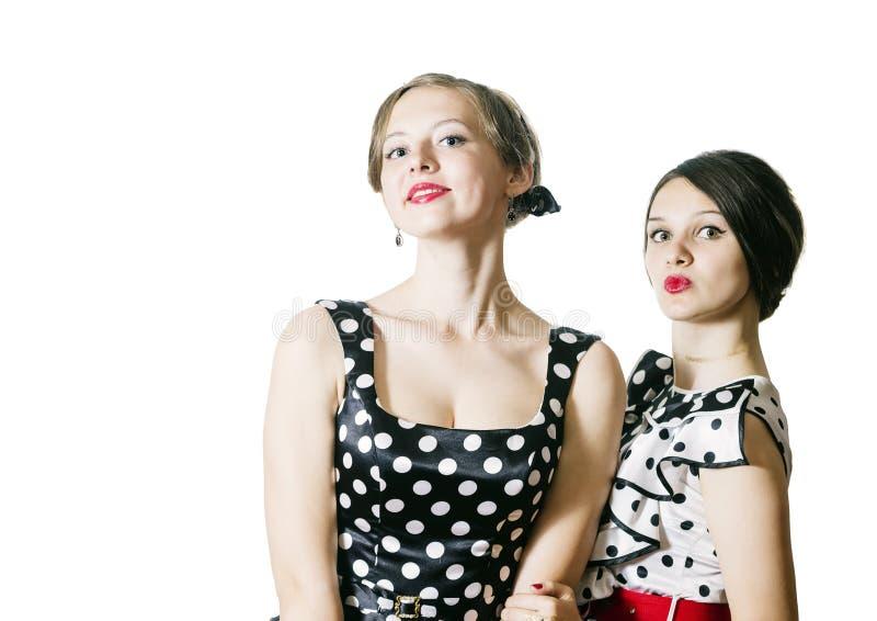 Retrato de dos muchachas en estilo del perno-para arriba fotografía de archivo libre de regalías