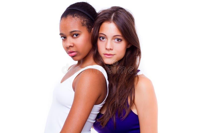 Retrato de duas meninas diferentes das nacionalidades imagem de stock royalty free