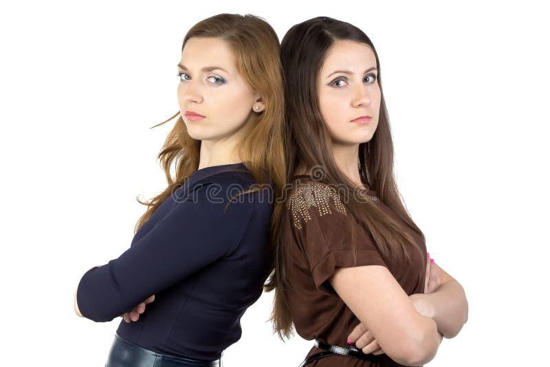 Retrato de duas mulheres sérias fotos de stock royalty free