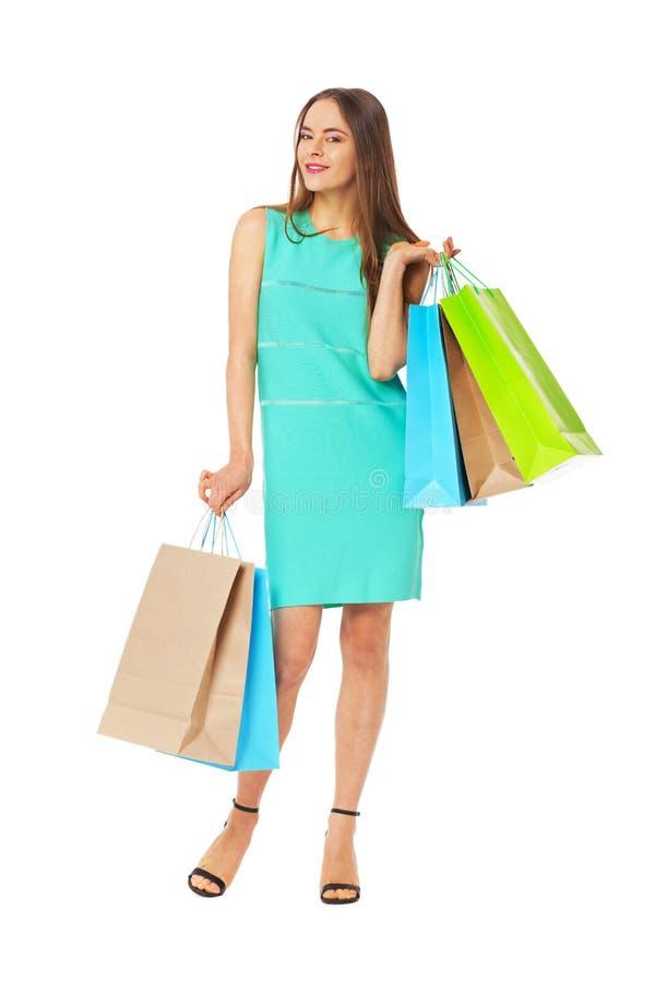 Retrato de Fullbody da mulher bonita com os sacos isolados no branco fotos de stock