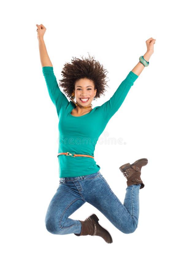 A mulher que salta na alegria imagens de stock royalty free