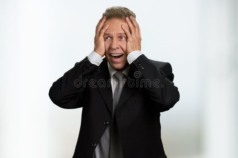 Retrato de homem de negócios de meia idade frustrante fotografia de stock