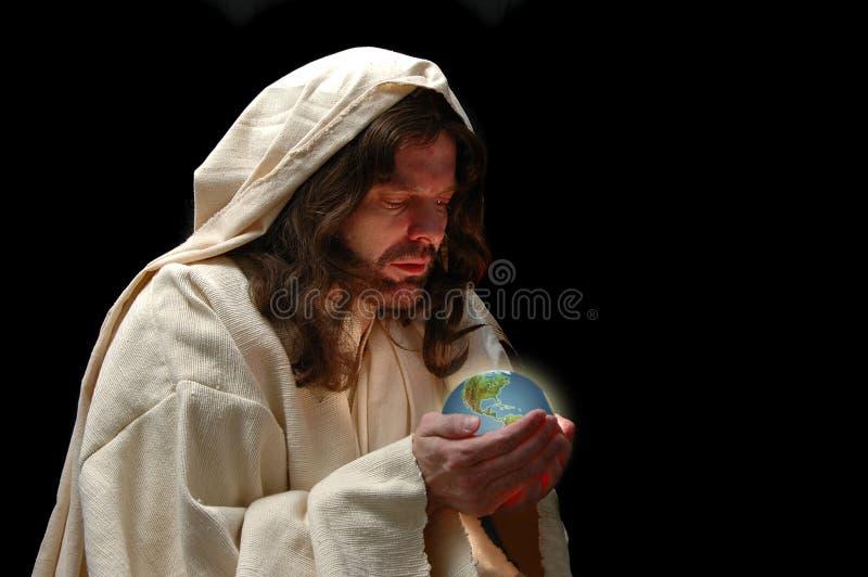 Retrato de Jesús que sostiene el mundo imágenes de archivo libres de regalías