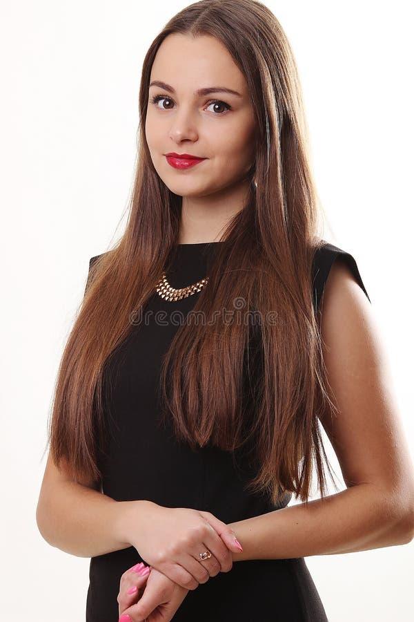 Retrato de la cara hermosa de una mujer joven con hai marrón largo imágenes de archivo libres de regalías