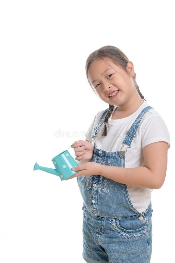Retrato de la edad linda del niño asiático de la muchacha 7 años en el fondo blanco fotos de archivo libres de regalías