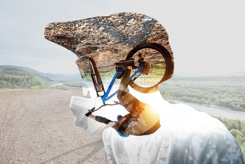 Retrato de la exposición doble de un ciclista foto de archivo libre de regalías