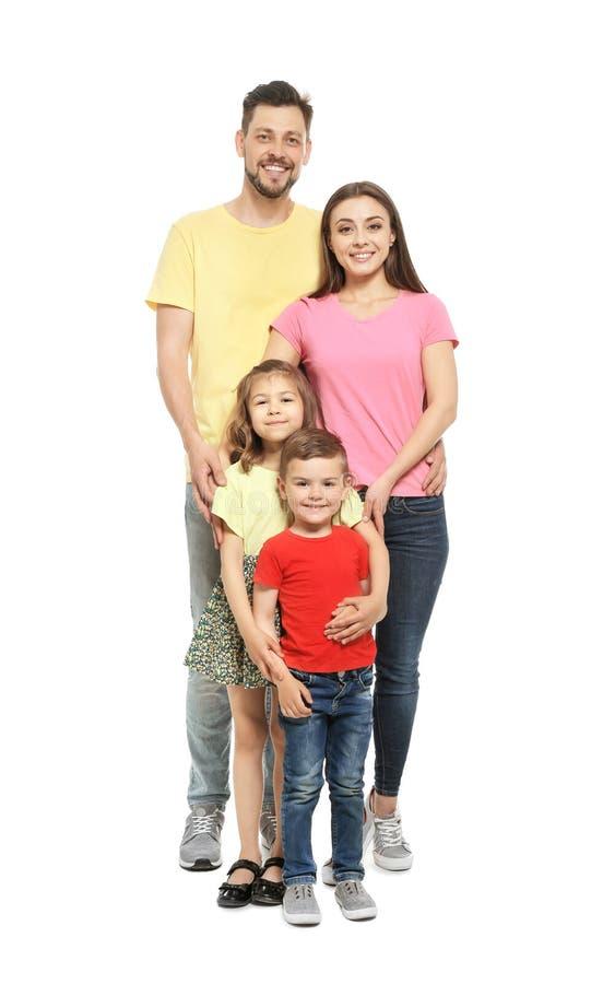 Retrato de la familia feliz con los niños lindos en el fondo blanco imagen de archivo libre de regalías