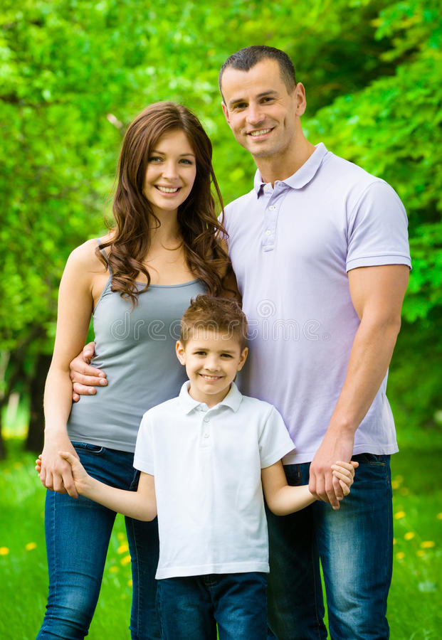 Retrato de la familia feliz de tres fotografía de archivo