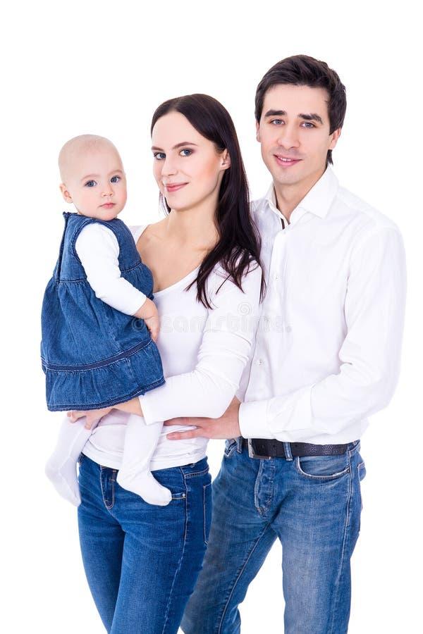 Retrato de la familia - padres jovenes felices con pequeño isola de la hija imagen de archivo