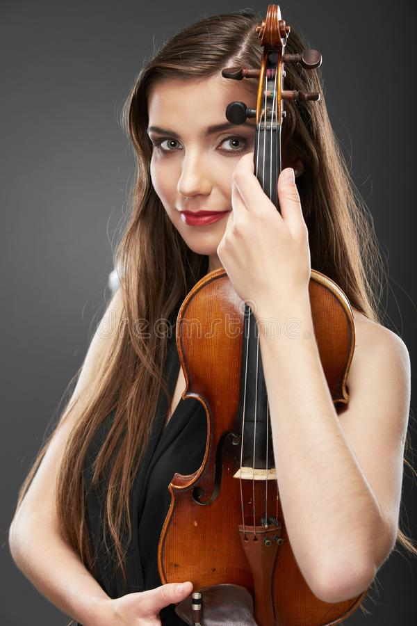 Retrato de la música de la mujer joven Juego del violín fotografía de archivo