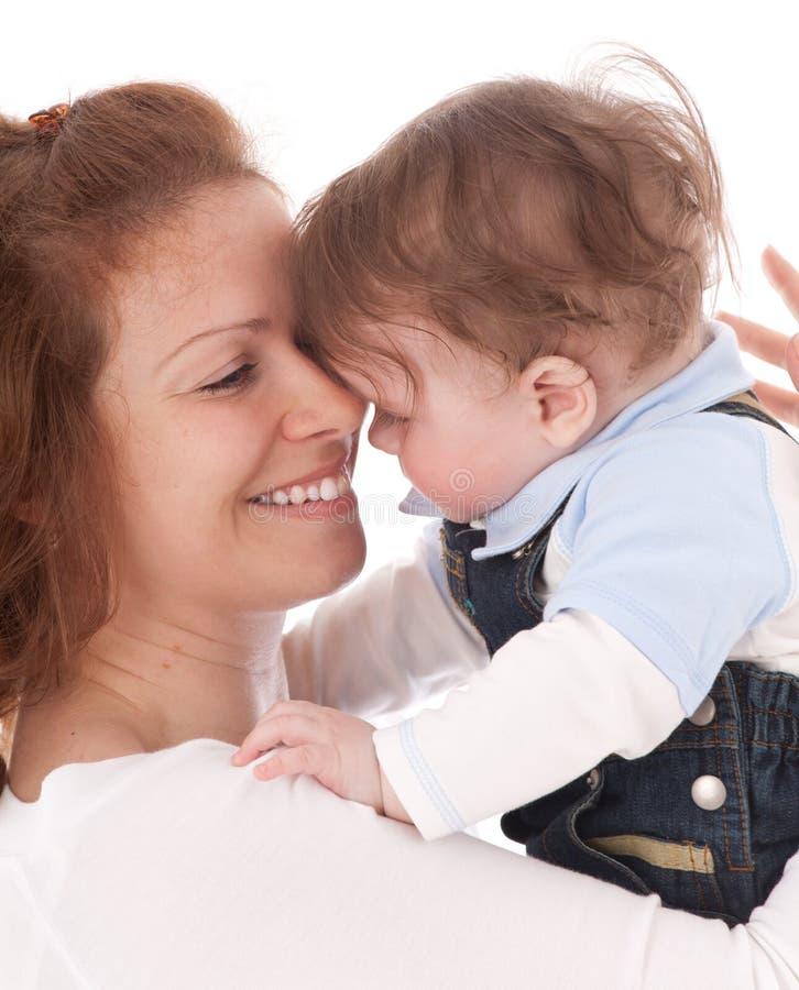 Retrato de la madre feliz con el bebé foto de archivo