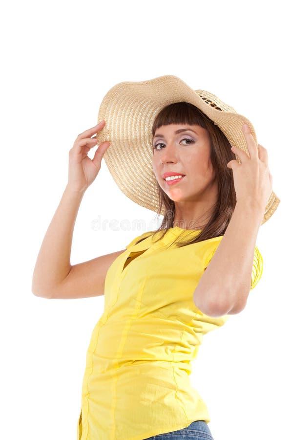 Retrato de la muchacha en un sombrero de paja fotografía de archivo libre de regalías