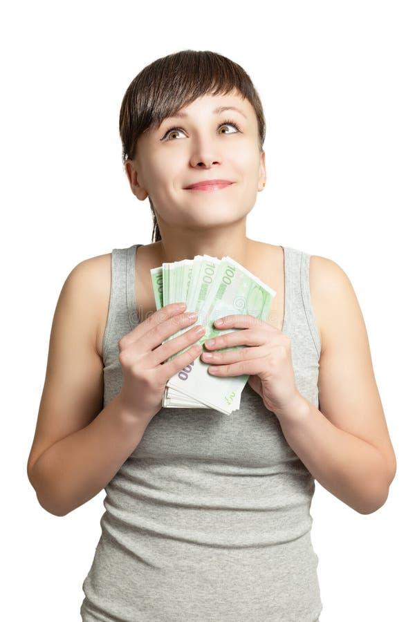 Retrato de la muchacha feliz con el dinero a disposición imagen de archivo