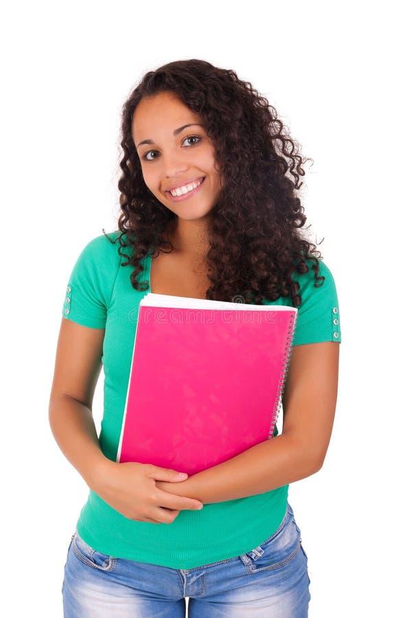 Retrato de la muchacha hermosa del estudiante con los libros imagenes de archivo