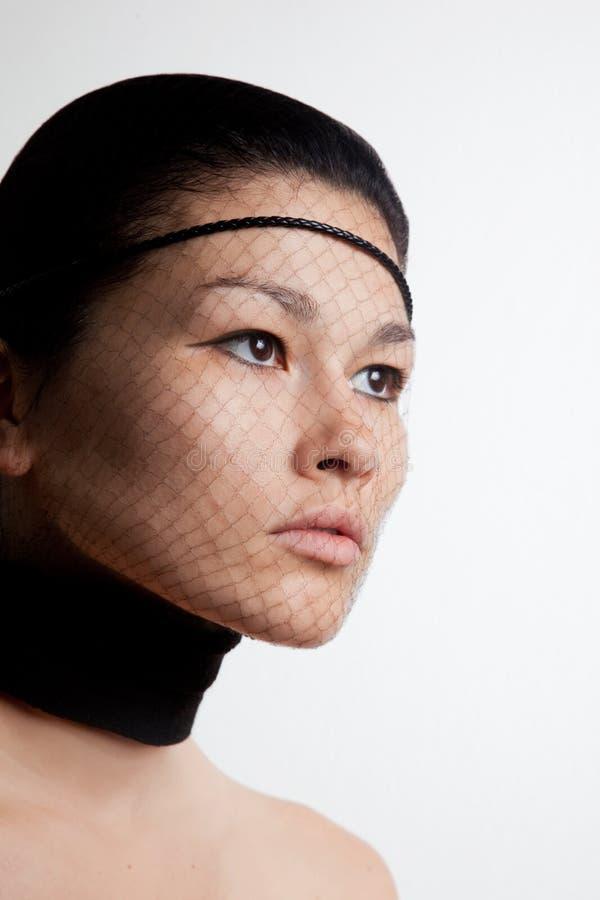 Retrato de la mujer con la red en la cara foto de archivo libre de regalías