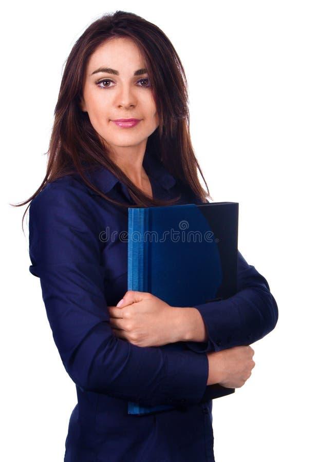 Retrato de la mujer de negocios con la carpeta en el fondo blanco imagen de archivo libre de regalías