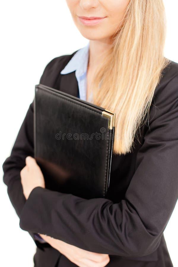Retrato de la mujer de negocios que sostiene una carpeta fotos de archivo