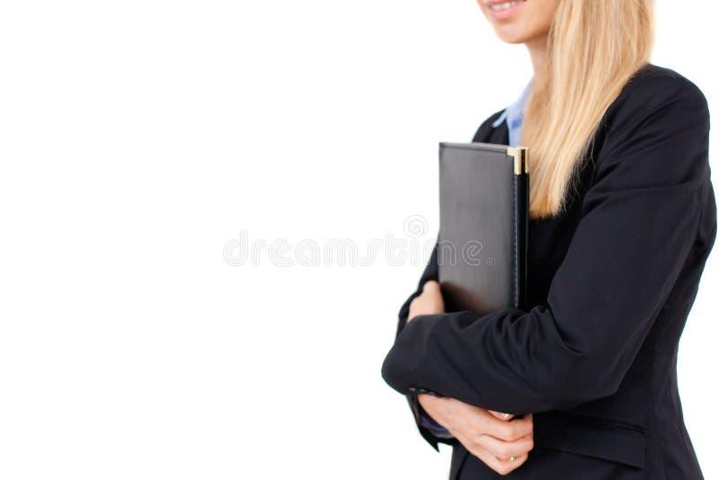 Retrato de la mujer de negocios que sostiene una carpeta fotografía de archivo libre de regalías