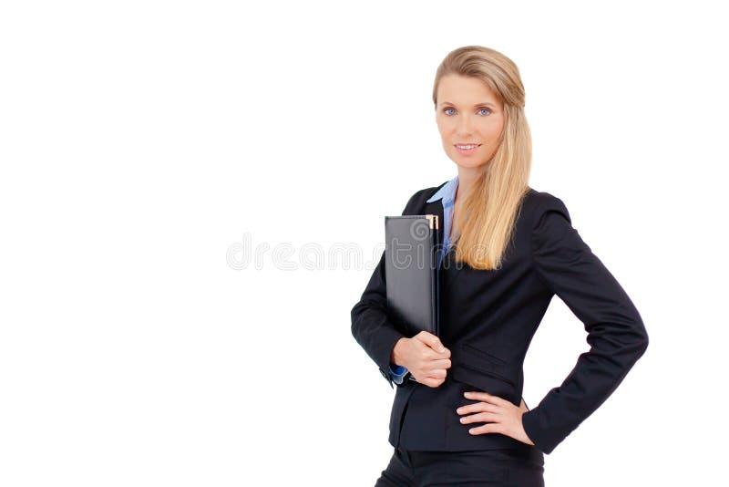 Retrato de la mujer de negocios que sostiene una carpeta fotografía de archivo