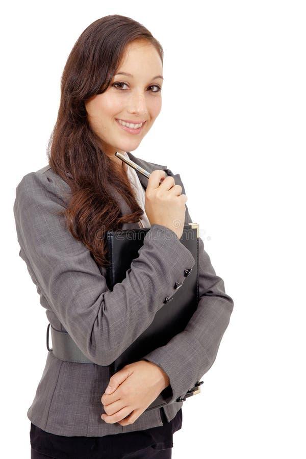 Retrato de la mujer de negocios que sostiene una carpeta foto de archivo
