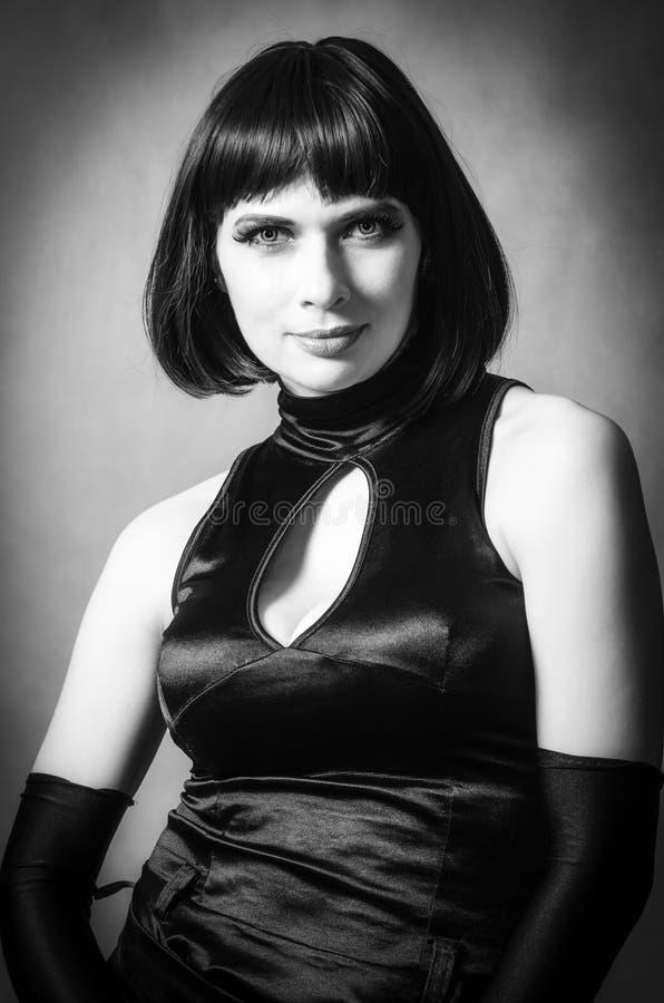 Retrato de la mujer en un vestido de noche y guantes largos fotos de archivo libres de regalías