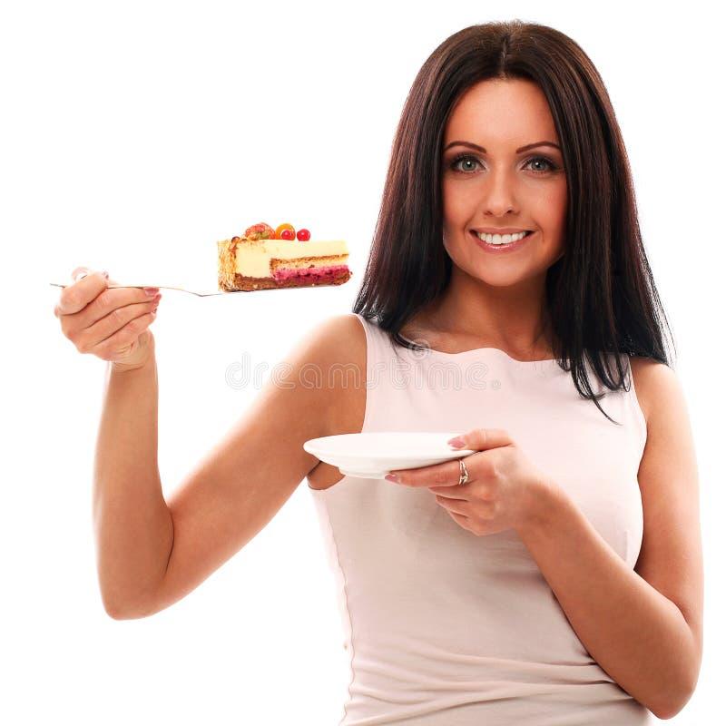 Retrato de la mujer hermosa con la torta foto de archivo