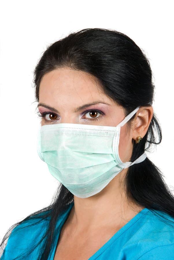 Retrato de la mujer joven con la máscara protectora imagen de archivo libre de regalías