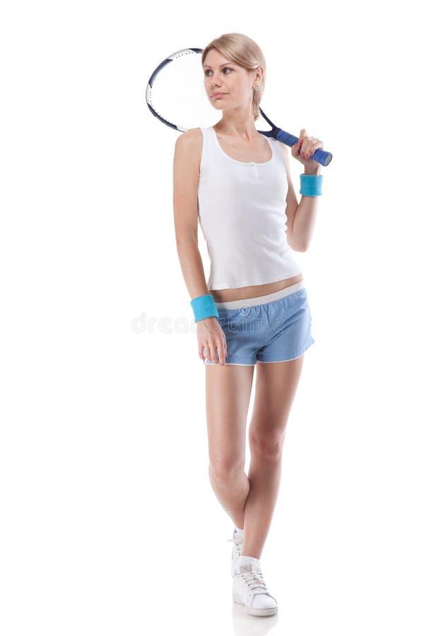 Retrato de la mujer joven con la raqueta de tenis imagen de archivo
