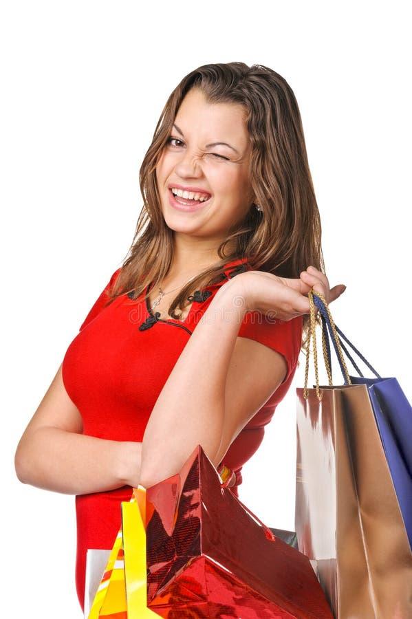 Retrato de la mujer joven con los bolsos de compras imagen de archivo