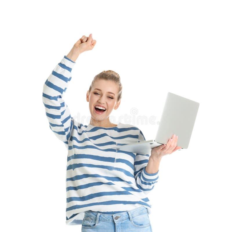 Retrato de la mujer joven emocional con el ordenador portátil fotografía de archivo libre de regalías