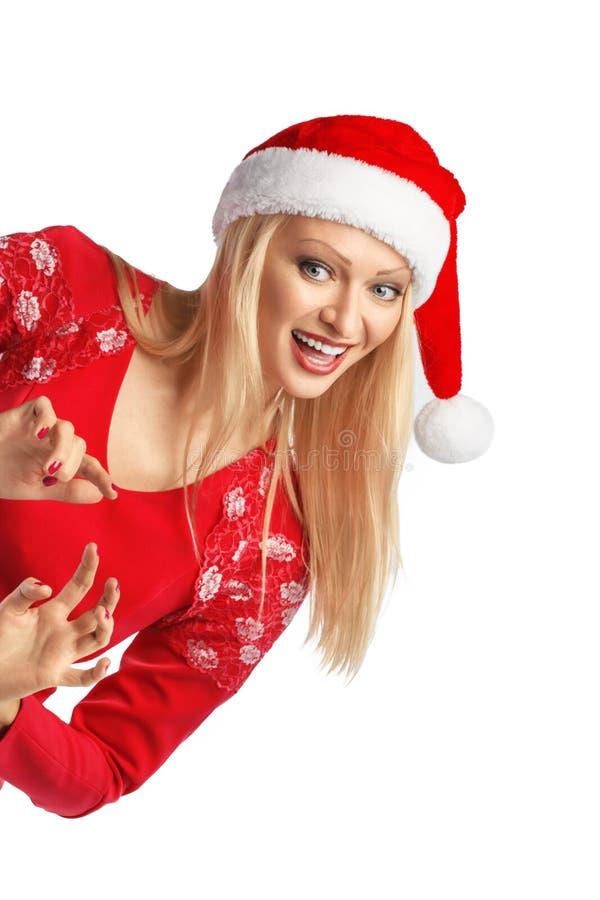 Retrato de la mujer joven en el sombrero de Papá Noel de la Navidad aislado. imagen de archivo libre de regalías