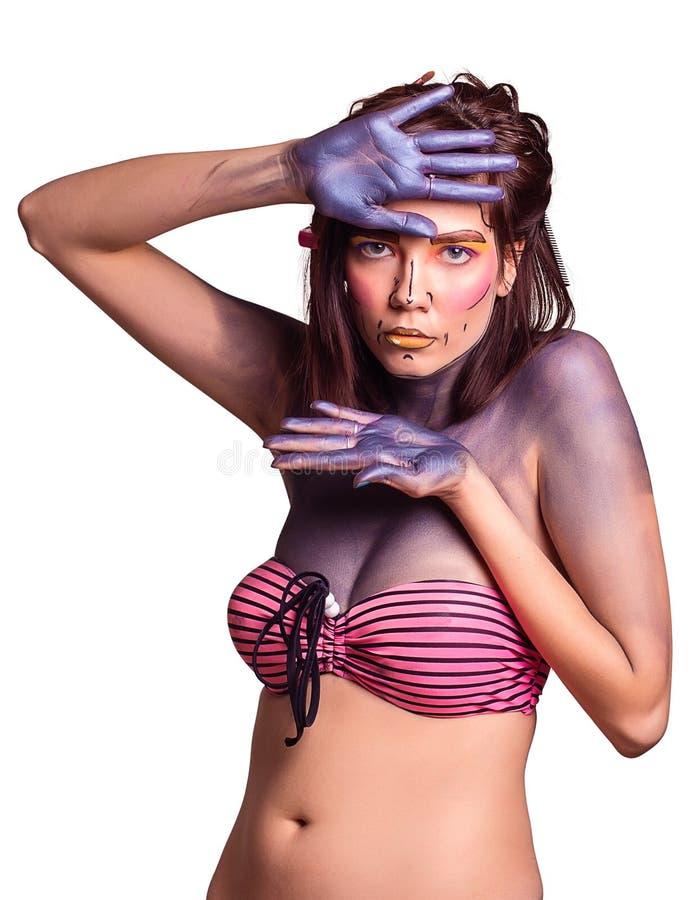 Retrato de la mujer joven hermosa con maquillaje creativo del arte pop imagenes de archivo