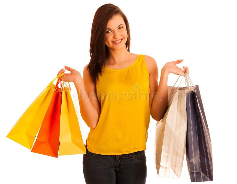 Retrato de la mujer sonriente feliz joven con los bolsos de compras, isolat fotografía de archivo libre de regalías