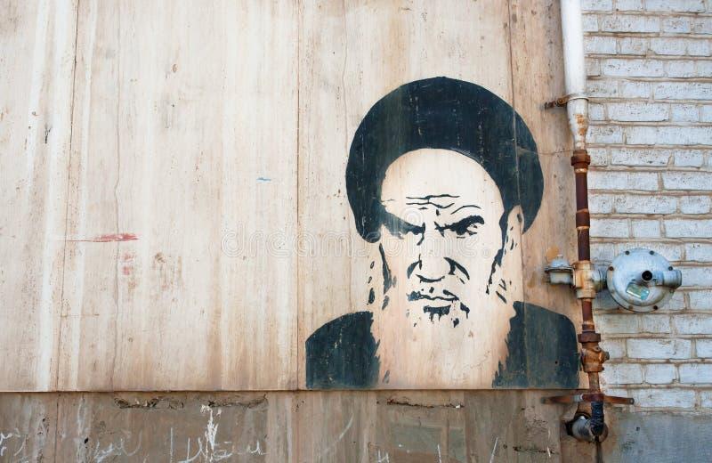 Retrato de la pintada del líder religioso iraní Ayatollah Khomeini imagen de archivo libre de regalías