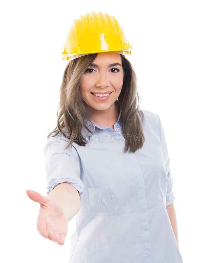 Retrato de la sacudida de ofrecimiento de la mano del constructor femenino fotos de archivo