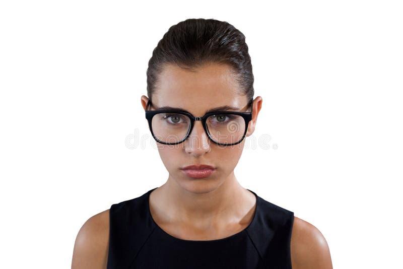 Retrato de las lentes que llevan de la empresaria joven seria fotografía de archivo